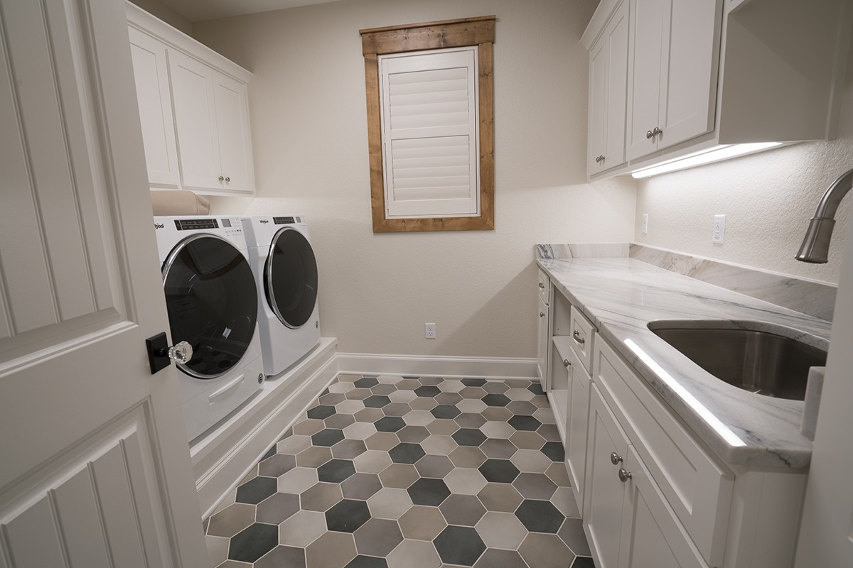 Lavish laundry room designed by Granite Division from Tyler Texas