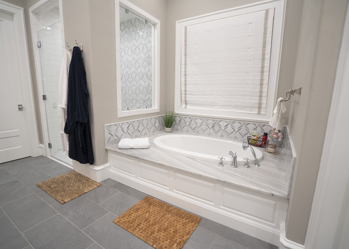 Luxurious bathtub in the bathroom made by Granite Division company from Tyler