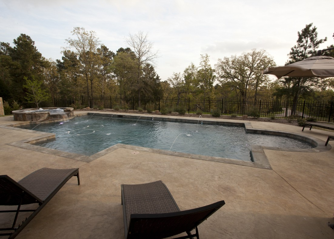 Open pool with details made by Granite Division from Tyler Texas