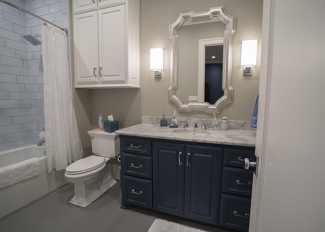 Luxurious bathroom with bathtub designed by Granite Division company from Tyler