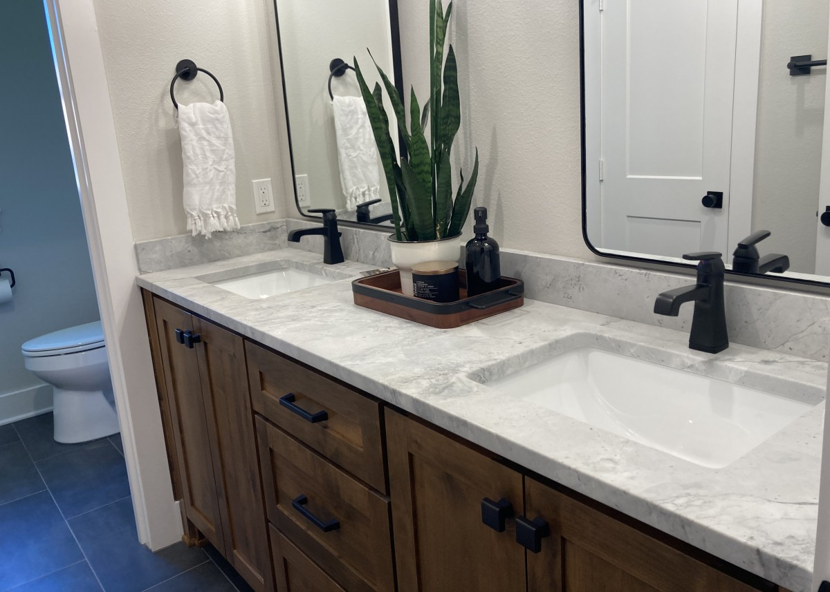 Bathroom double sink designed by Granite Division company from Tyler