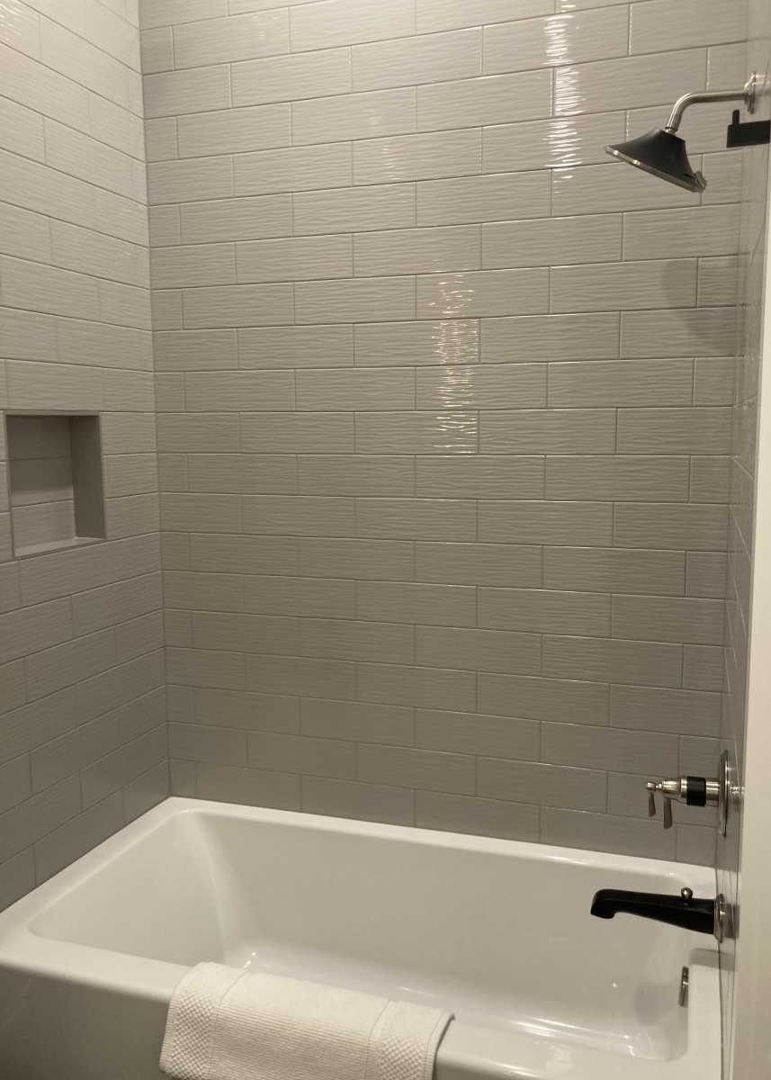Bathroom wall with tiles designed by Granite Division company from Tyler