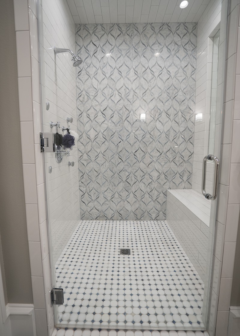 Luxurious shower with tile floor designed by Granite Division company from Tyler