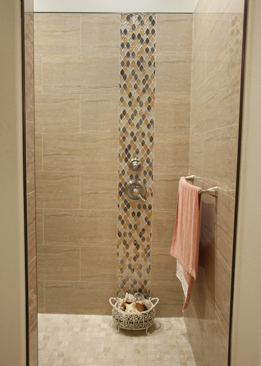 Bathroom wall in the shower with tiles designed by Granite Division company from Tyler