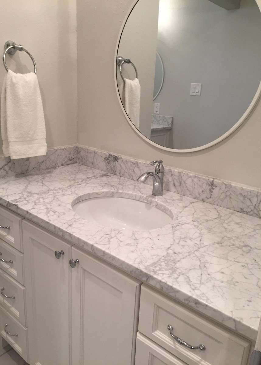 Bathroom cabinets with panel made by Granite Division company from Tyler