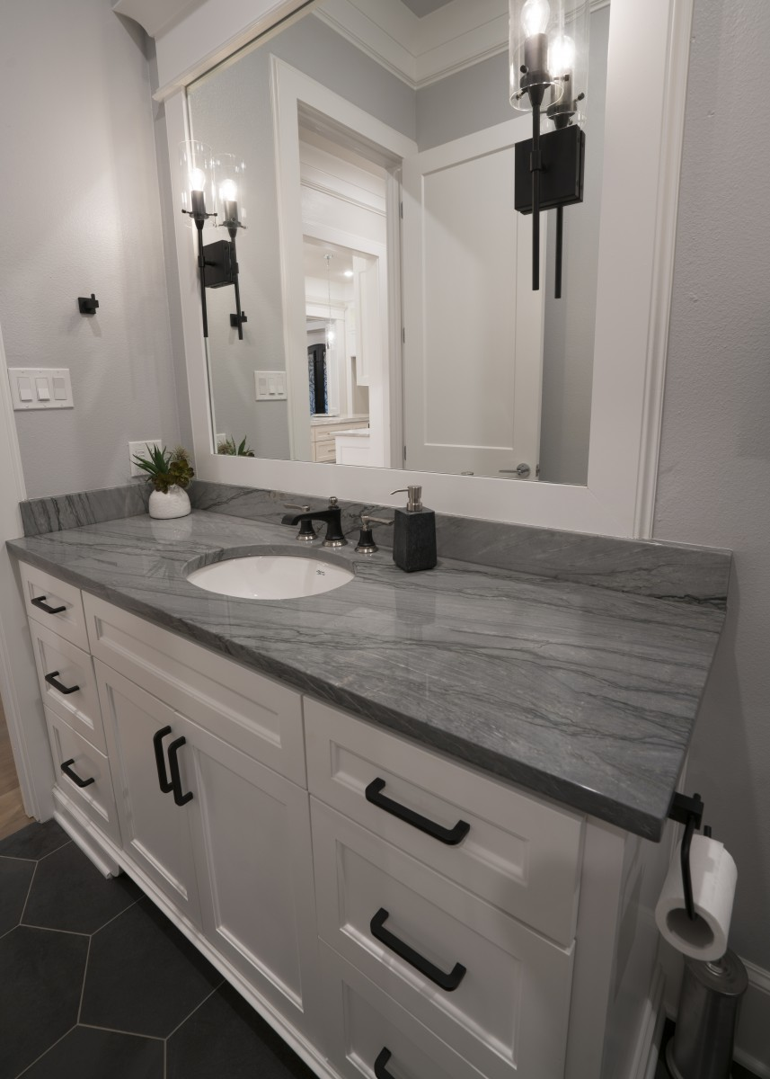 Bathroom cabinets with panel made by Granite Division company from Tyler Texas