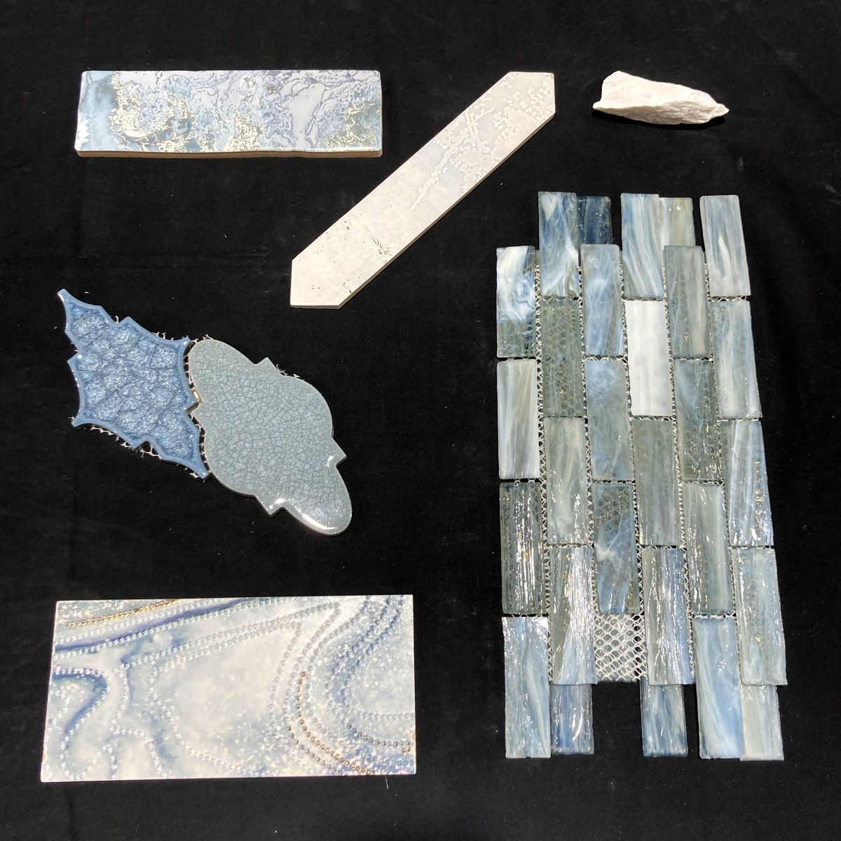 A mix of blue and white porcelain and glass tiles.